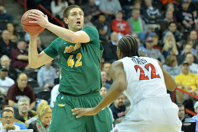 March 22, 2014: North Dakota State Bison forward Marshall Bjorklund (42) surveys the defense during a third round game of the NCAA Division I Men's Basketball Championship between the 4-seed San Diego State and the 12-seed North Dakota State at Spokane Arena in Spokane, Wash. San Diego State defeated North Dakota State 66-43 to advance to the Sweet Sixteen.