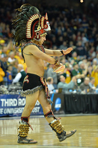 March 22, 2014: The Aztec Warrior performs during a third round game of the NCAA Division I Men's Basketball Championship between the 4-seed San Diego State and the 12-seed North Dakota State at Spokane Arena in Spokane, Wash. San Diego State defeated North Dakota State 66-43 to advance to the Sweet Sixteen.