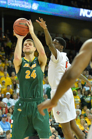 March 22, 2014: North Dakota State Bison guard Taylor Braun (24) takes a shot during a third round game of the NCAA Division I Men's Basketball Championship between the 4-seed San Diego State and the 12-seed North Dakota State at Spokane Arena in Spokane, Wash. San Diego State defeated North Dakota State 66-43 to advance to the Sweet Sixteen.