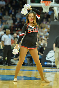 March 22, 2014: A member of the San Diego State Aztecs cheerleaders performs during a third round game of the NCAA Division I Men's Basketball Championship between the 4-seed San Diego State and the 12-seed North Dakota State at Spokane Arena in Spokane, Wash. San Diego State defeated North Dakota State 66-43 to advance to the Sweet Sixteen.
