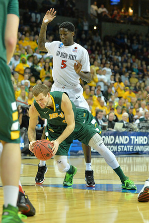 March 22, 2014: North Dakota State Bison guard Taylor Braun (24) is fouled by San Diego State Aztecs forward Dwayne Polee II (5) during a third round game of the NCAA Division I Men's Basketball Championship between the 4-seed San Diego State and the 12-seed North Dakota State at Spokane Arena in Spokane, Wash. San Diego State defeated North Dakota State 66-43 to advance to the Sweet Sixteen.