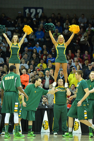 March 22, 2014: North Dakota State Bison cheerleaders perform during a third round game of the NCAA Division I Men's Basketball Championship between the 4-seed San Diego State and the 12-seed North Dakota State at Spokane Arena in Spokane, Wash. San Diego State defeated North Dakota State 66-43 to advance to the Sweet Sixteen.