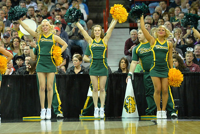 March 22, 2014: North Dakota State Bison cheerleaders celebrate a Bison basket during a third round game of the NCAA Division I Men's Basketball Championship between the 4-seed San Diego State and the 12-seed North Dakota State at Spokane Arena in Spokane, Wash. San Diego State defeated North Dakota State 66-43 to advance to the Sweet Sixteen.