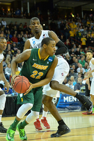 March 22, 2014: North Dakota State Bison guard Kory Brown (22) tries to get around the San Diego State Aztecs defense during a third round game of the NCAA Division I Men's Basketball Championship between the 4-seed San Diego State and the 12-seed North Dakota State at Spokane Arena in Spokane, Wash. San Diego State defeated North Dakota State 66-43 to advance to the Sweet Sixteen.