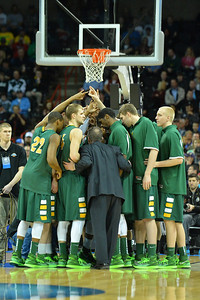March 22, 2014: The North Dakota State Bison huddle before the tip off of a third round game of the NCAA Division I Men's Basketball Championship between the 4-seed San Diego State and the 12-seed North Dakota State at Spokane Arena in Spokane, Wash. San Diego State defeated North Dakota State 66-43 to advance to the Sweet Sixteen.