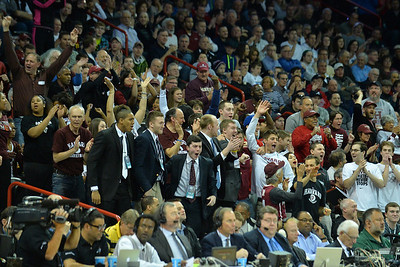 March 20, 2014: Harvard Crimson fans celebrate a made basket during a second round game of the NCAA Division I Men's Basketball Championship between the 5-seed Cincinnati Bearcats and the 12-seed Harvard Crimson at Spokane Arena in Spokane, Wash. Harvard defeated Cincinnati 61-57.