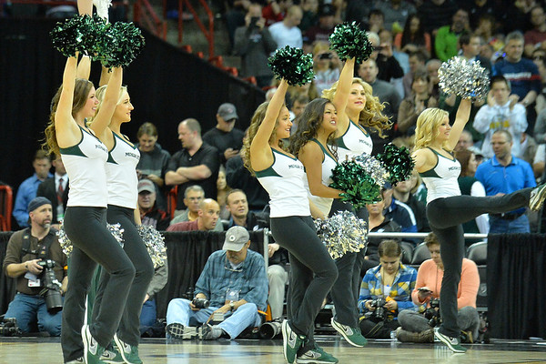 March 20, 2014: Michigan State Spartans cheerleaders perform during a second round game of the NCAA Division I Men's Basketball Championship between the 4-seed Michigan State and the 13-seed Delaware at Spokane Arena in Spokane, Wash. Michigan State defeated Delaware 93-78.
