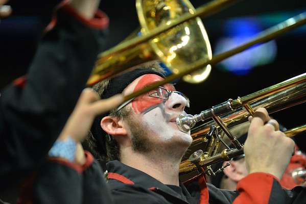 March 20, 2014: A member of the Cincinnati Bearcats pep band plays during a second round game of the NCAA Division I Men's Basketball Championship between the 5-seed Cincinnati Bearcats and the 12-seed Harvard Crimson at Spokane Arena in Spokane, Wash. Harvard defeated Cincinnati 61-57.