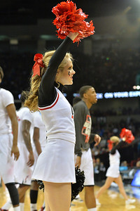 March 20, 2014: A Cincinnati Bearcats cheerleader performs during a second round game of the NCAA Division I Men's Basketball Championship between the 5-seed Cincinnati Bearcats and the 12-seed Harvard Crimson at Spokane Arena in Spokane, Wash. Harvard defeated Cincinnati 61-57.