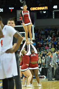 March 20, 2014: Harvard Crimson cheerleaders perform during a second round game of the NCAA Division I Men's Basketball Championship between the 5-seed Cincinnati Bearcats and the 12-seed Harvard Crimson at Spokane Arena in Spokane, Wash. Harvard defeated Cincinnati 61-57.