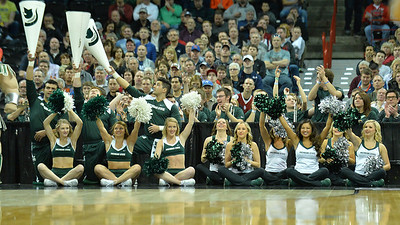 March 20, 2014: Michigan State Spartans cheerleaders celebrate a Spartan basket during a second round game of the NCAA Division I Men's Basketball Championship between the 4-seed Michigan State and the 13-seed Delaware at Spokane Arena in Spokane, Wash. Michigan State defeated Delaware 93-78.