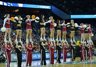 March 20, 2015: Wichita State Shockers and Indiana Hoosiers cheerleaders perform during a second round game between No. 7 Wichita State and No. 10 Indiana in the 2015 NCAA Men's Basketball Championship Tournament at CenturyLink Center in Omaha, Neb. Wichita State defeated Indiana 81-76.