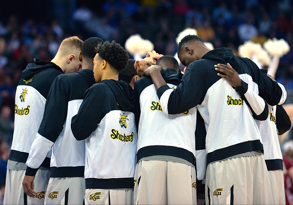 March 20, 2015: Wichita State Shockers players huddle before the start of a second round game between No. 7 Wichita State and No. 10 Indiana in the 2015 NCAA Men's Basketball Championship Tournament at CenturyLink Center in Omaha, Neb. Wichita State defeated Indiana 81-76.