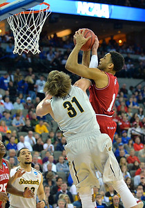 March 20, 2015: Wichita State Shockers guard Ron Baker (31) tries to contest a shot by Indiana Hoosiers guard James Blackmon Jr. (1) during a second round game between No. 7 Wichita State and No. 10 Indiana in the 2015 NCAA Men's Basketball Championship Tournament at CenturyLink Center in Omaha, Neb. Wichita State defeated Indiana 81-76.