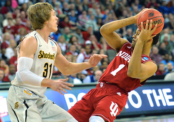 March 20, 2015: Indiana Hoosiers guard James Blackmon Jr. (1) fights around the defense of Wichita State Shockers guard Ron Baker (31) during a second round game between No. 7 Wichita State and No. 10 Indiana in the 2015 NCAA Men's Basketball Championship Tournament at CenturyLink Center in Omaha, Neb. Wichita State defeated Indiana 81-76.