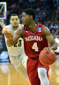 March 20, 2015: Indiana Hoosiers guard Robert Johnson (4) eludes Wichita State Shockers guard Fred VanVleet (23) during a second round game between No. 7 Wichita State and No. 10 Indiana in the 2015 NCAA Men's Basketball Championship Tournament at CenturyLink Center in Omaha, Neb. Wichita State defeated Indiana 81-76.