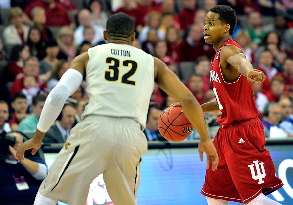 March 20, 2015: Indiana Hoosiers guard Yogi Ferrell (11) directs his team during a second round game between No. 7 Wichita State and No. 10 Indiana in the 2015 NCAA Men's Basketball Championship Tournament at CenturyLink Center in Omaha, Neb. Wichita State defeated Indiana 81-76.