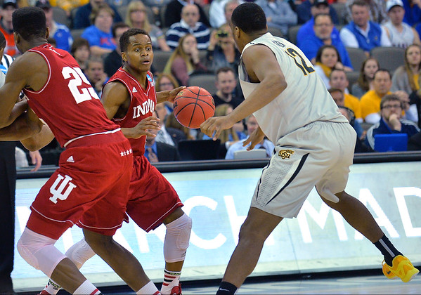 March 20, 2015: Indiana Hoosiers guard Yogi Ferrell (11) looks to drive past Wichita State Shockers forward Darius Carter (12) during a second round game between No. 7 Wichita State and No. 10 Indiana in the 2015 NCAA Men's Basketball Championship Tournament at CenturyLink Center in Omaha, Neb. Wichita State defeated Indiana 81-76.