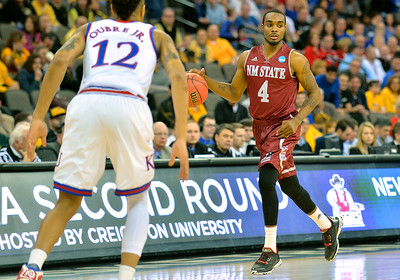 March 20, 2015: New Mexico State Aggies guard Ian Baker (4) brings the ball into the front court during a second round game between No. 2 seed Kansas and No. 15 seed New Mexico State in the 2015 NCAA Men's Basketball Championship Tournament at CenturyLink Center in Omaha, Neb. Kansas defeated New Mexico State 76-57. Kansas defeated New Mexico State 76-57. Kansas defeated New Mexico State 76-57.