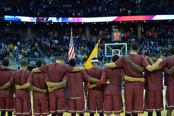 March 20, 2015: New Mexico State Aggies players line up for the National Anthem before a second round game between No. 2 seed Kansas and No. 15 seed New Mexico State in the 2015 NCAA Men's Basketball Championship Tournament at CenturyLink Center in Omaha, Neb. Kansas defeated New Mexico State 76-57.
