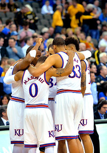 March 20, 2015: The Kansas Jayhawks starters huddle before a second round game between No. 2 seed Kansas and No. 15 seed New Mexico State in the 2015 NCAA Men's Basketball Championship Tournament at CenturyLink Center in Omaha, Neb. Kansas defeated New Mexico State 76-57. Kansas defeated New Mexico State 76-57. Kansas defeated New Mexico State 76-57.