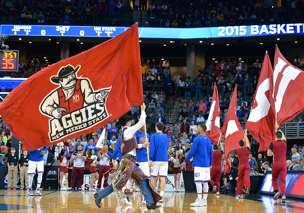 March 20, 2015: The New Mexico State Aggies mascot Pistol Pete runs the Aggies' flag on the court before a second round game between No. 2 seed Kansas and No. 15 seed New Mexico State in the 2015 NCAA Men's Basketball Championship Tournament at CenturyLink Center in Omaha, Neb. Kansas defeated New Mexico State 76-57. Kansas defeated New Mexico State 76-57. Kansas defeated New Mexico State 76-57.