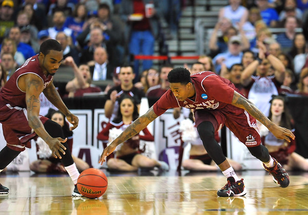March 20, 2015: New Mexico State Aggies guard Daniel Mullings (23) and New Mexico State Aggies guard Ian Baker (4) go after a loose ball during a second round game between No. 2 seed Kansas and No. 15 seed New Mexico State in the 2015 NCAA Men's Basketball Championship Tournament at CenturyLink Center in Omaha, Neb. Kansas defeated New Mexico State 76-57. Kansas defeated New Mexico State 76-57. Kansas defeated New Mexico State 76-57.