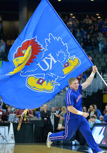 March 20, 2015: A Kansas Jayhawks cheerleader waves the Jayhawks flag before a second round game between No. 2 seed Kansas and No. 15 seed New Mexico State in the 2015 NCAA Men's Basketball Championship Tournament at CenturyLink Center in Omaha, Neb. Kansas defeated New Mexico State 76-57. Kansas defeated New Mexico State 76-57. Kansas defeated New Mexico State 76-57.