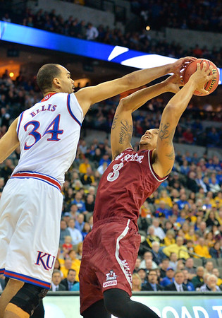 March 20, 2015: New Mexico State Aggies forward Remi Barry (3) is blocked by Kansas Jayhawks forward Perry Ellis (34) during a second round game between No. 2 seed Kansas and No. 15 seed New Mexico State in the 2015 NCAA Men's Basketball Championship Tournament at CenturyLink Center in Omaha, Neb. Kansas defeated New Mexico State 76-57. Kansas defeated New Mexico State 76-57. Kansas defeated New Mexico State 76-57.