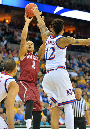 March 20, 2015: New Mexico State Aggies forward Remi Barry (3) shoots over Kansas Jayhawks guard Kelly Oubre Jr. (12) during a second round game between No. 2 seed Kansas and No. 15 seed New Mexico State in the 2015 NCAA Men's Basketball Championship Tournament at CenturyLink Center in Omaha, Neb. Kansas defeated New Mexico State 76-57. Kansas defeated New Mexico State 76-57. Kansas defeated New Mexico State 76-57.