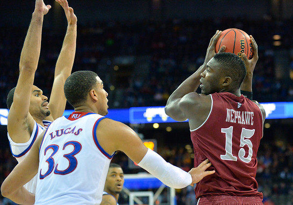 March 20, 2015: New Mexico State Aggies center Tshilidzi Nephawe (15) looks for a teammate to pass to during a second round game between No. 2 seed Kansas and No. 15 seed New Mexico State in the 2015 NCAA Men's Basketball Championship Tournament at CenturyLink Center in Omaha, Neb. Kansas defeated New Mexico State 76-57. Kansas defeated New Mexico State 76-57. Kansas defeated New Mexico State 76-57.