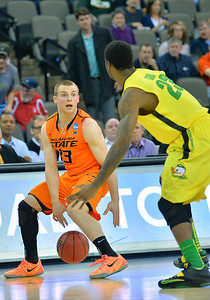 March 20, 2015: Oklahoma State Cowboys guard Phil Forte III (13) looks to dribble past Oregon Ducks forward Elgin Cook (23) during a second round game between No. 8 Oregon and No. 9 Oklahoma State in the 2015 NCAA Men's Basketball Championship Tournament at CenturyLink Center in Omaha, Neb. Oregon defeated Oklahoma State 79-73.