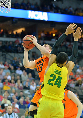 March 20, 2015: Oklahoma State Cowboys guard Phil Forte III (13) puts up a shot around Oregon Ducks forward Dillon Brooks (24) during a second round game between No. 8 Oregon and No. 9 Oklahoma State in the 2015 NCAA Men's Basketball Championship Tournament at CenturyLink Center in Omaha, Neb. Oregon defeated Oklahoma State 79-73.