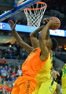March 20, 2015: Oklahoma State Cowboys guard/forward Le'Bryan Nash (2) has his shot blocked during a second round game between No. 8 Oregon and No. 9 Oklahoma State in the 2015 NCAA Men's Basketball Championship Tournament at CenturyLink Center in Omaha, Neb. Oregon defeated Oklahoma State 79-73.