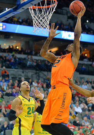 March 20, 2015: Oklahoma State Cowboys guard/forward Le'Bryan Nash (2) goes up for a dunk during a second round game between No. 8 Oregon and No. 9 Oklahoma State in the 2015 NCAA Men's Basketball Championship Tournament at CenturyLink Center in Omaha, Neb. Oregon defeated Oklahoma State 79-73.