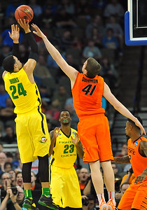 March 20, 2015: Oklahoma State Cowboys forward/center Mitchell Solomon (41) contests a shot by Oregon Ducks forward Dillon Brooks (24) during a second round game between No. 8 Oregon and No. 9 Oklahoma State in the 2015 NCAA Men's Basketball Championship Tournament at CenturyLink Center in Omaha, Neb. Oregon defeated Oklahoma State 79-73.