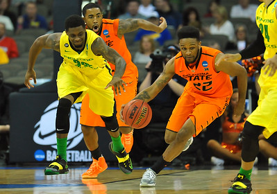 March 20, 2015: Oklahoma State Cowboys guard Jeff Newberry (22) brings the ball up the court during a second round game between No. 8 Oregon and No. 9 Oklahoma State in the 2015 NCAA Men's Basketball Championship Tournament at CenturyLink Center in Omaha, Neb. Oregon defeated Oklahoma State 79-73.