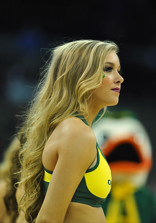 March 20, 2015: An Oregon Ducks cheerleader watches the player introductions before a second round game between No. 8 Oregon and No. 9 Oklahoma State in the 2015 NCAA Men's Basketball Championship Tournament at CenturyLink Center in Omaha, Neb. Oregon defeated Oklahoma State 79-73.