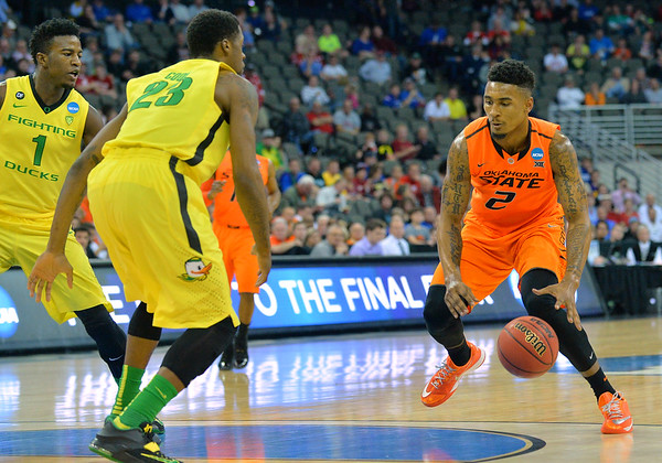 March 20, 2015: Oklahoma State Cowboys guard/forward Le'Bryan Nash (2) looks to drive past Oregon Ducks forward Elgin Cook (23) during a second round game between No. 8 Oregon and No. 9 Oklahoma State in the 2015 NCAA Men's Basketball Championship Tournament at CenturyLink Center in Omaha, Neb. Oregon defeated Oklahoma State 79-73.