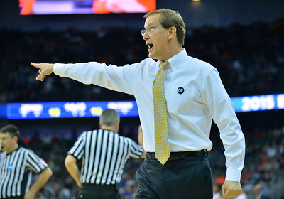 March 20, 2015: Oregon Ducks head coach Dana Altman shouts instructions to his team during a second round game between No. 8 Oregon and No. 9 Oklahoma State in the 2015 NCAA Men's Basketball Championship Tournament at CenturyLink Center in Omaha, Neb. Oregon defeated Oklahoma State 79-73.