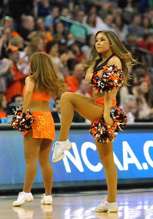 March 20, 2015: An Oklahoma State Cowboys cheerleader performs during a second round game between No. 8 Oregon and No. 9 Oklahoma State in the 2015 NCAA Men's Basketball Championship Tournament at CenturyLink Center in Omaha, Neb. Oregon defeated Oklahoma State 79-73.