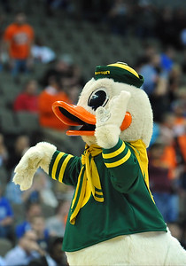 March 20, 2015: The Oregon Ducks mascot Puddles waves to the crowd before a second round game between No. 8 Oregon and No. 9 Oklahoma State in the 2015 NCAA Men's Basketball Championship Tournament at CenturyLink Center in Omaha, Neb. Oregon defeated Oklahoma State 79-73.