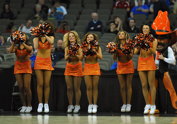 March 20, 2015: Oklahoma State Cowboys cheerleaders perform before a second round game between No. 8 Oregon and No. 9 Oklahoma State in the 2015 NCAA Men's Basketball Championship Tournament at CenturyLink Center in Omaha, Neb. Oregon defeated Oklahoma State 79-73.
