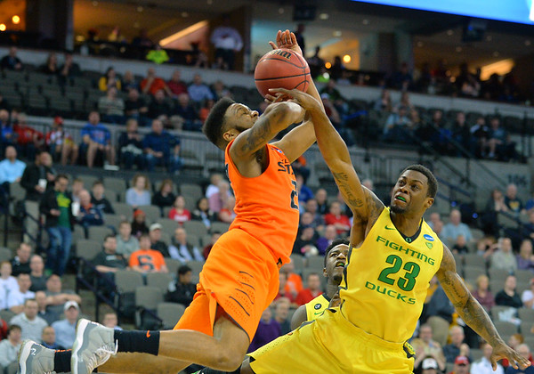 March 20, 2015: Oklahoma State Cowboys guard Jeff Newberry (22) has his shot blocked by Oregon Ducks forward Elgin Cook (23) during a second round game between No. 8 Oregon and No. 9 Oklahoma State in the 2015 NCAA Men's Basketball Championship Tournament at CenturyLink Center in Omaha, Neb. Oregon defeated Oklahoma State 79-73.