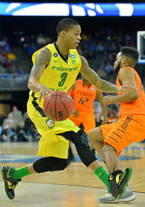 March 20, 2015: Oregon Ducks guard Joseph Young (3) dribbles in the backcourt during a second round game between No. 8 Oregon and No. 9 Oklahoma State in the 2015 NCAA Men's Basketball Championship Tournament at CenturyLink Center in Omaha, Neb. Oregon defeated Oklahoma State 79-73.