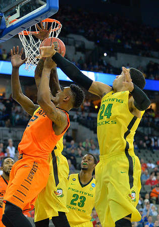 March 20, 2015: Oklahoma State Cowboys guard/forward Le'Bryan Nash (2) has his shot blocked by Oregon Ducks forward Dillon Brooks (24) during a second round game between No. 8 Oregon and No. 9 Oklahoma State in the 2015 NCAA Men's Basketball Championship Tournament at CenturyLink Center in Omaha, Neb. Oregon defeated Oklahoma State 79-73.