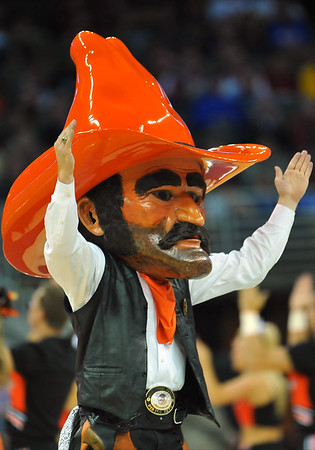 March 20, 2015: The Oklahoma State Cowboys mascot Pistol Pete performs during a second round game between No. 8 Oregon and No. 9 Oklahoma State in the 2015 NCAA Men's Basketball Championship Tournament at CenturyLink Center in Omaha, Neb. Oregon defeated Oklahoma State 79-73.