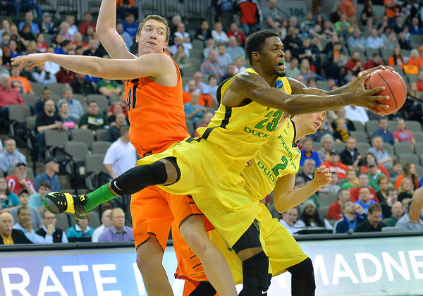 March 20, 2015: Oregon Ducks forward Elgin Cook (23) grabs a rebound during a second round game between No. 8 Oregon and No. 9 Oklahoma State in the 2015 NCAA Men's Basketball Championship Tournament at CenturyLink Center in Omaha, Neb. Oregon defeated Oklahoma State 79-73.