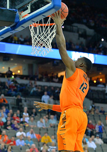 March 20, 2015: Oklahoma State Cowboys guard Anthony Hickey Jr. (12) gets a layup during a second round game between No. 8 Oregon and No. 9 Oklahoma State in the 2015 NCAA Men's Basketball Championship Tournament at CenturyLink Center in Omaha, Neb. Oregon defeated Oklahoma State 79-73.