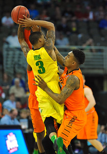 March 20, 2015: Oregon Ducks guard Joseph Young (3) has his shot contested by Oklahoma State Cowboys guard/forward Le'Bryan Nash (2) during a second round game between No. 8 Oregon and No. 9 Oklahoma State in the 2015 NCAA Men's Basketball Championship Tournament at CenturyLink Center in Omaha, Neb. Oregon defeated Oklahoma State 79-73.